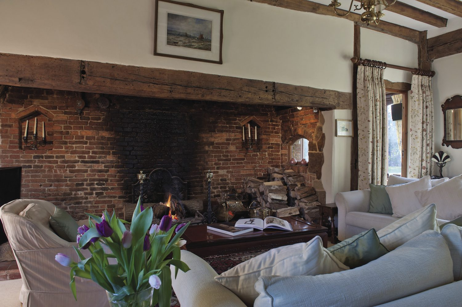 In the drawing room the fireplace stretches almost the whole length of one wall