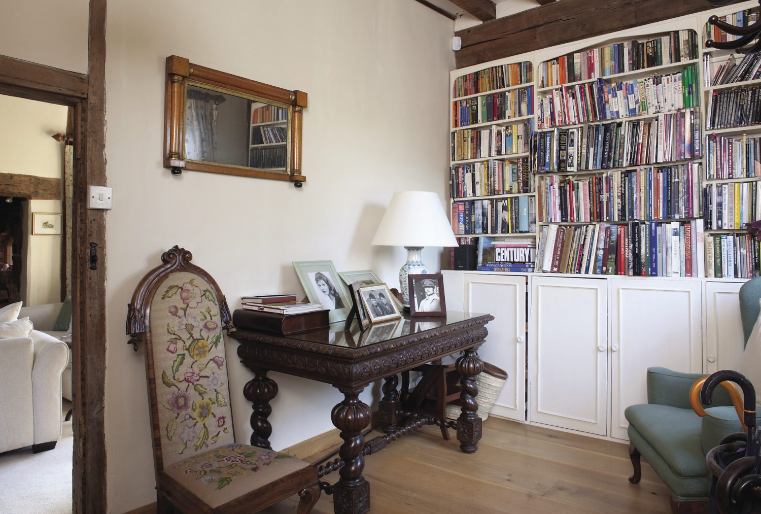 Bookshelves line the walls of the study