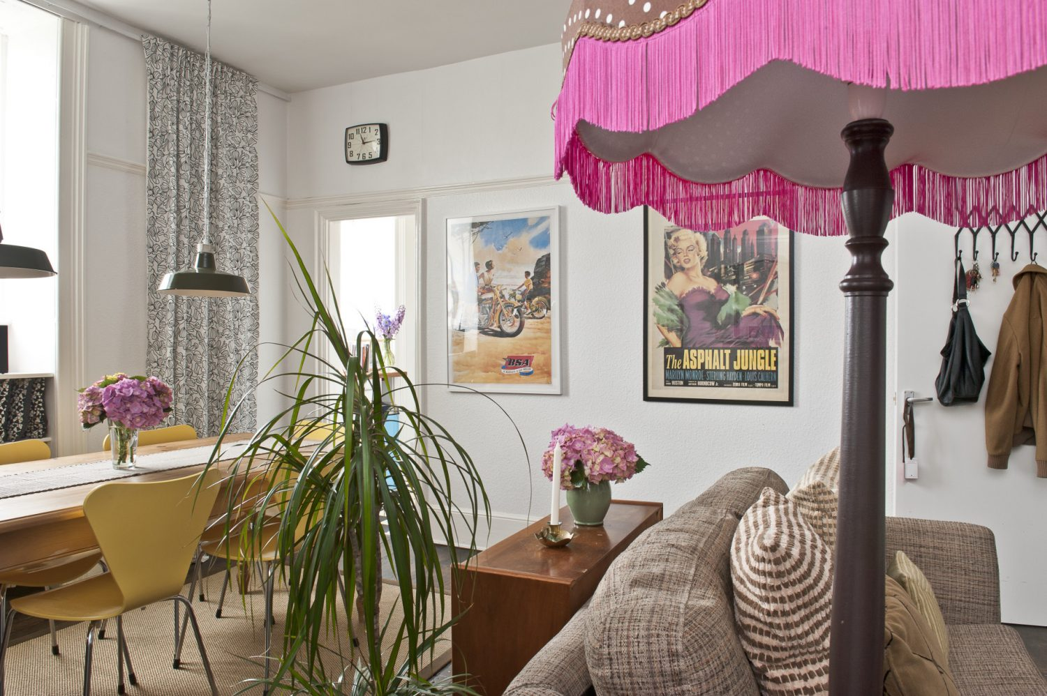 Charlotte's flat's main reception room is subtly divided into a sitting and dining room merely by the arrangement of furniture. On a long wall hangs a 1950s advertising poster for BSA motorcycles. Next to it is another icon of 50s glamour – Marilyn Monroe reclines seductively on a film poster for The Asphalt Jungle.