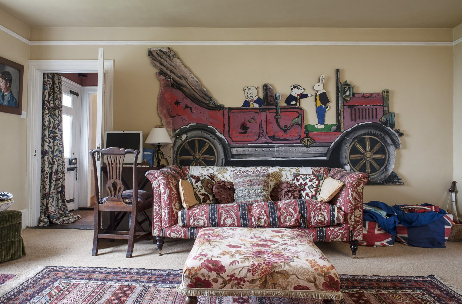 Dominating one wall of the children's playroom is a striking piece of Chitty Chitty Bang Bang theatre set from Mccully & Crane in Rye
