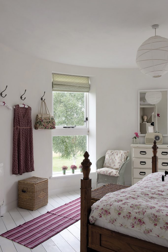The guest bedroom. The windows in all the roundels are superb, virtually floor to ceiling, and look out over some lovely views of the garden and countryside beyond