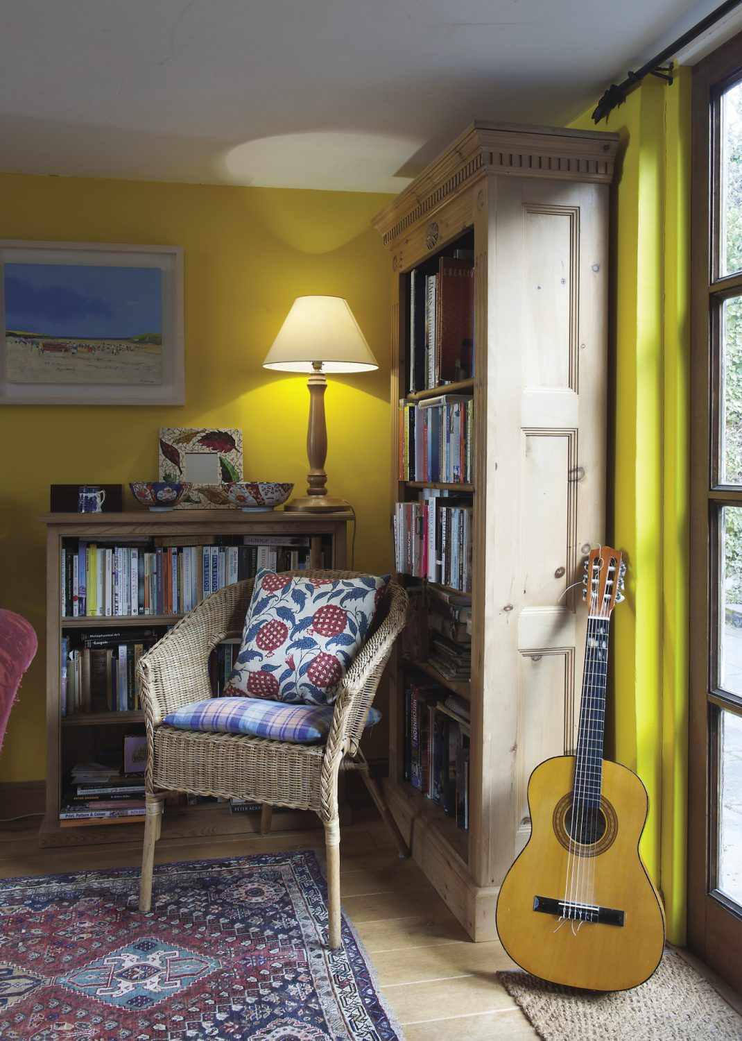 An accoustic guitar propped in one corner alludes to Oliver's phenomenal music collection