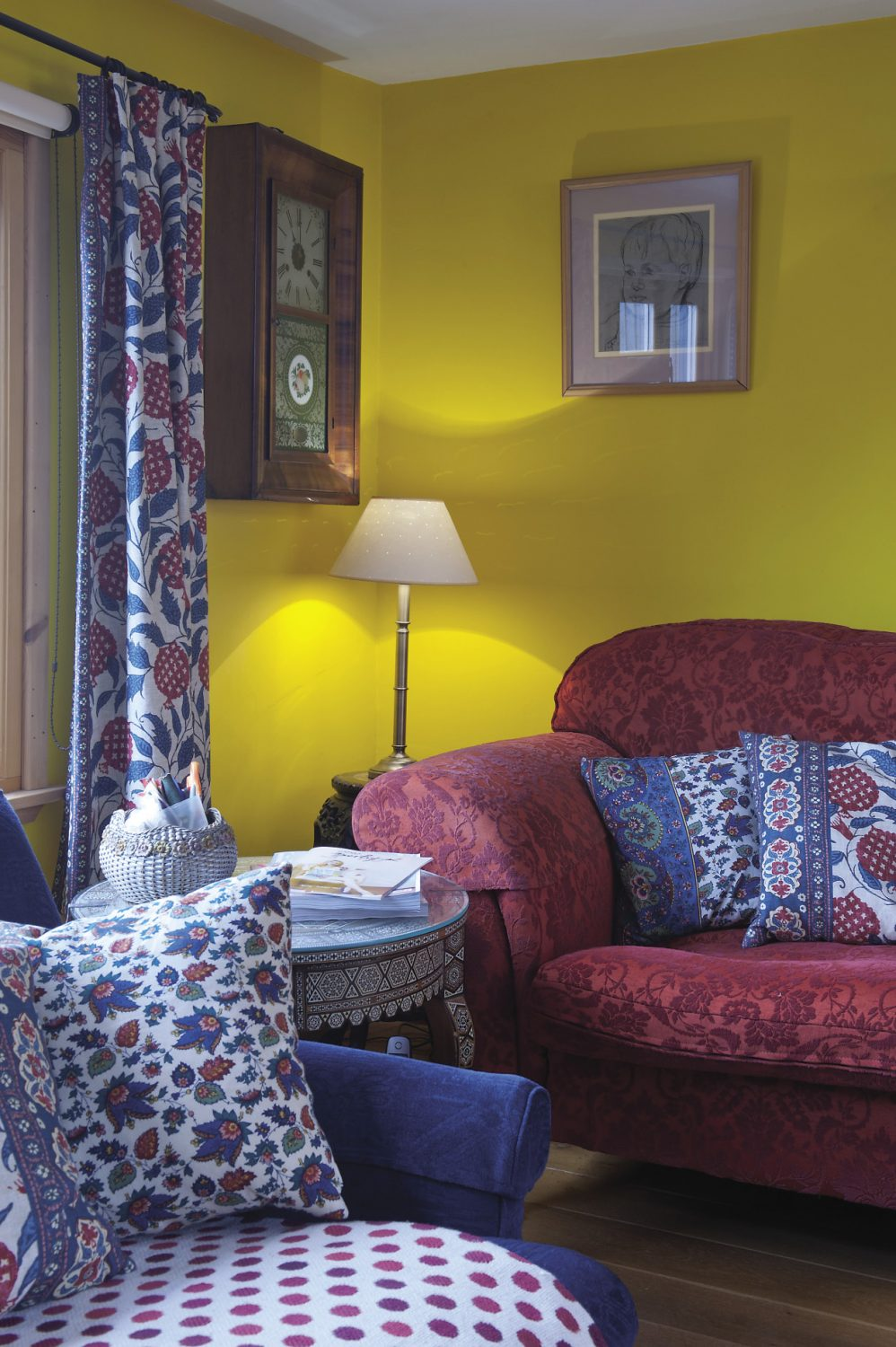 In the sitting room bookshelves are crammed with art and design books. The three sofas are draped with woven woollen throws and an assortment of cushions including some that are covered in a heavy cotton printed with a pomegranate motif, a fabric that Fiona found at Hoopers in Tunbridge Wells