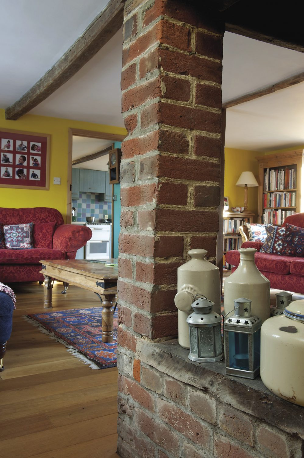 The focal pnt of the sitting room is a huge brick inglenook fireplace with a woodburning stove