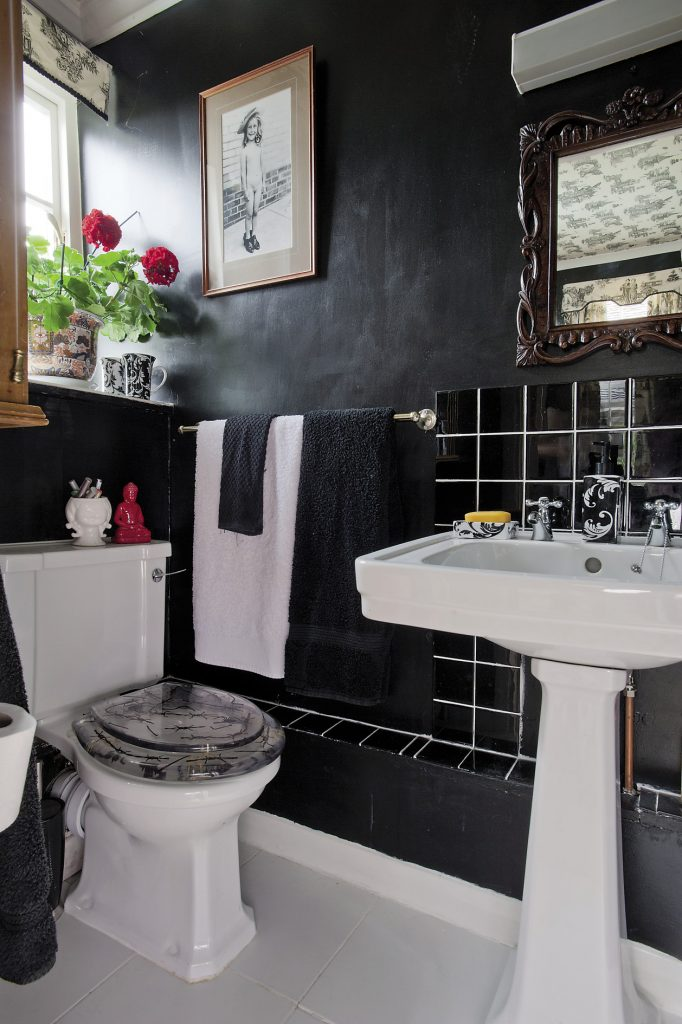 The black theme continues into the en suite, complete with barbed-wire toilet seat!