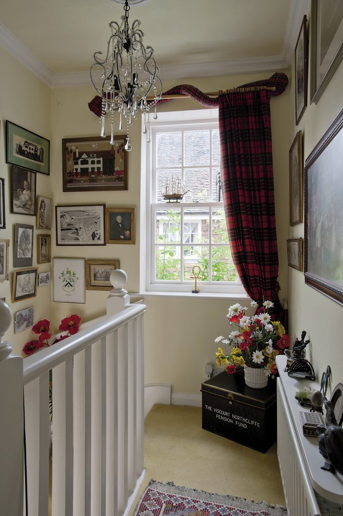 The walls on the ascent to the first floor are filled with cherished family photographs and artworks