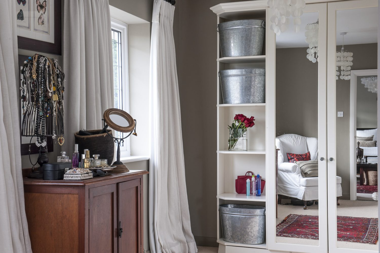 The bright dressing room provides ample storage for clothes and accessories