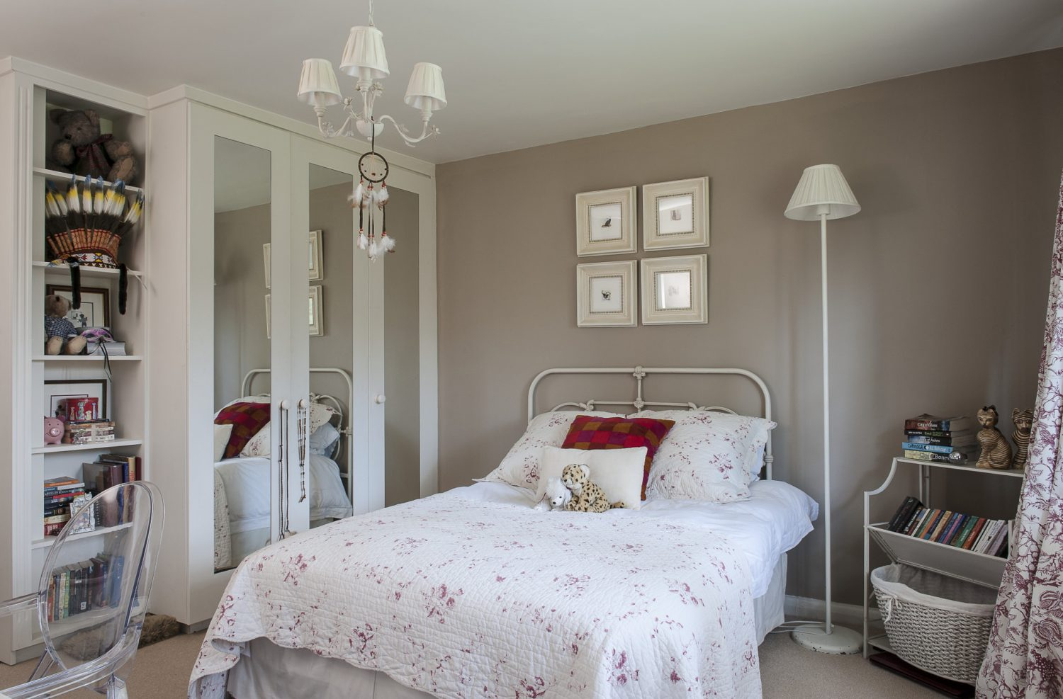 Adele's daughter's room is a blizzard of white with warmth provided by the raspberry étoile curtains. The bed's cast-iron headpiece came with her from South Africa