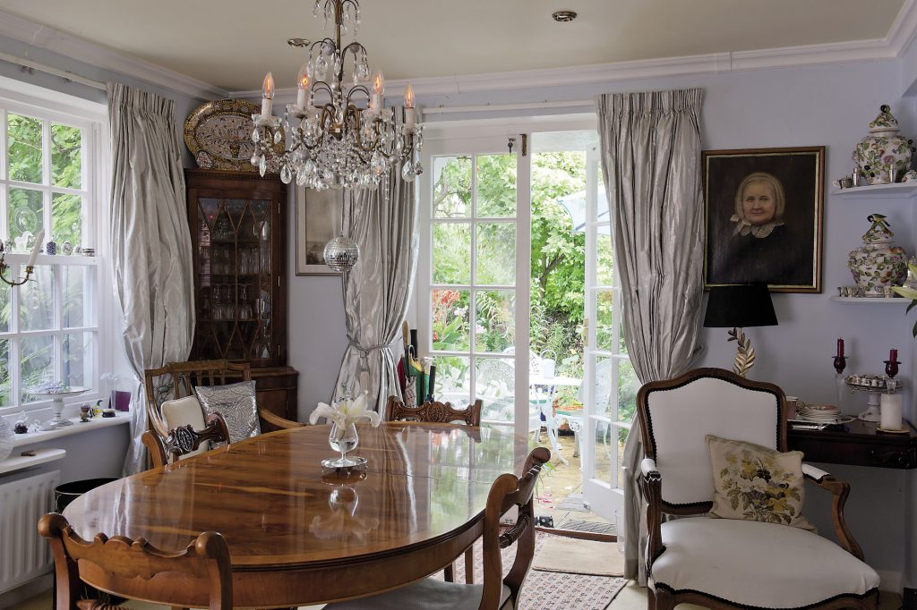 Chairs upholstered in beautifully soft white leather are gathered around the dining table. Erica has made the very best of every available square centimetre but has added a wealth of fascinating features which make a guided tour a joy