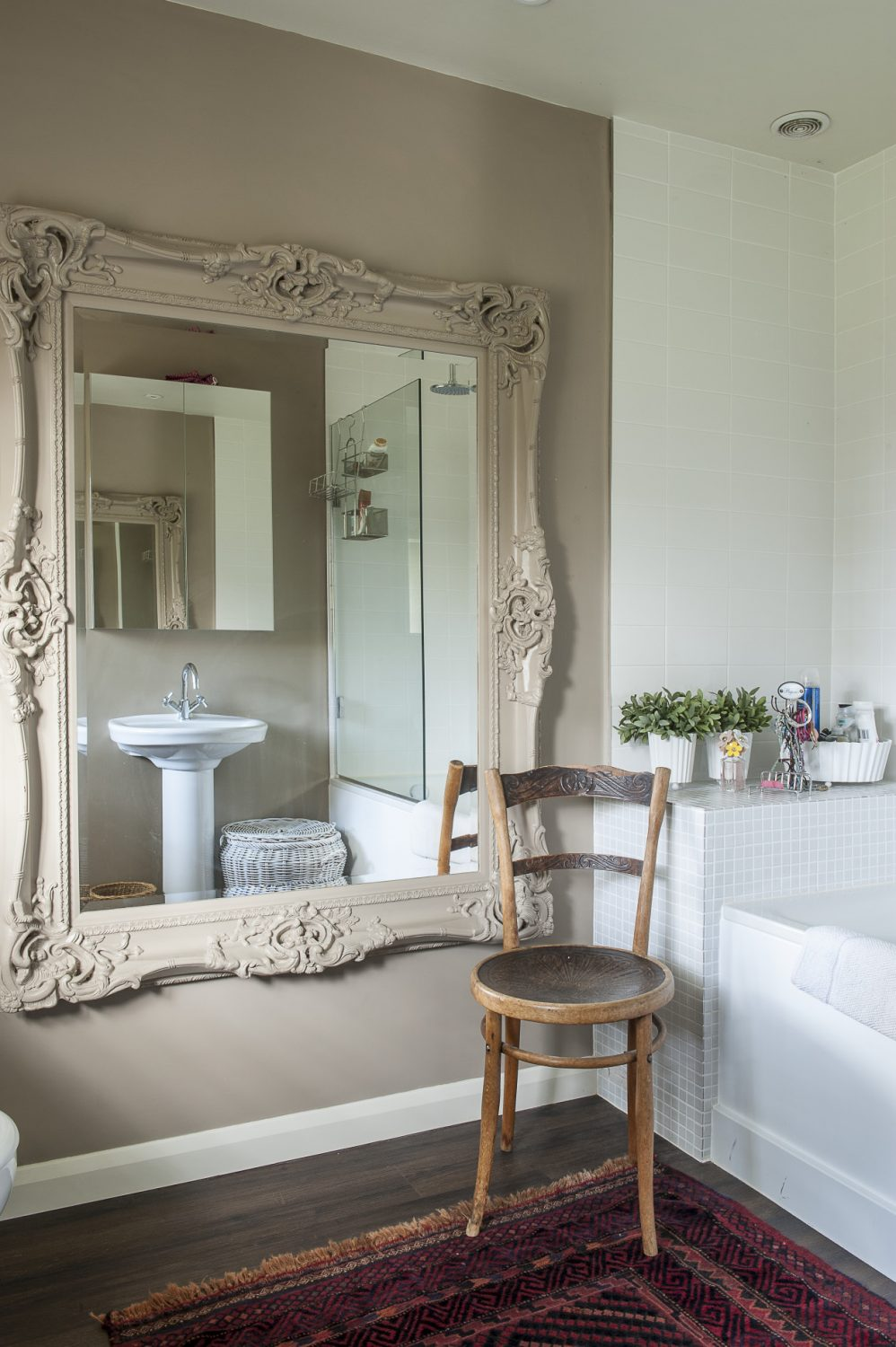 In the en suite, the frame of a large ornate mirror from Blooms has been very effectively painted the same F&B as the walls