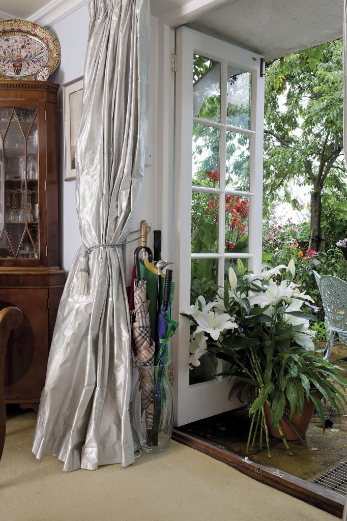 """""""The living room floods with sun. The 70% silk with 30% Lurex Dupion curtains haven't faded after eleven years!"""" Erica explains"""