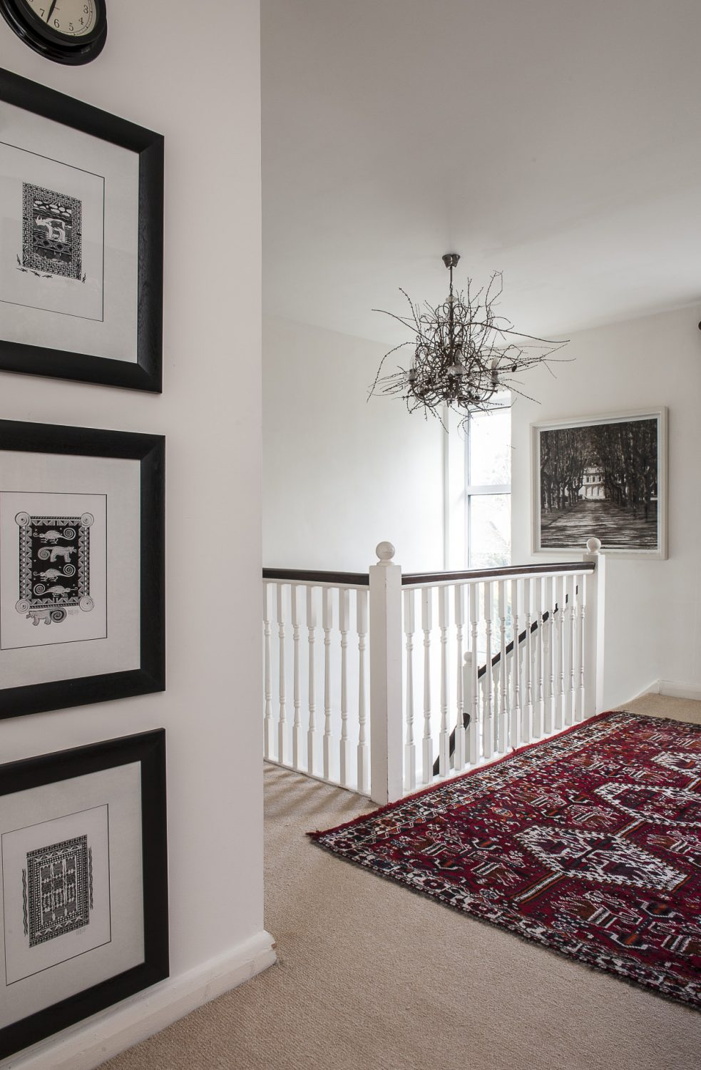 On the top floor landing is a chandelier that, at Christmas, the family decorated with twigs gathered on a country walk