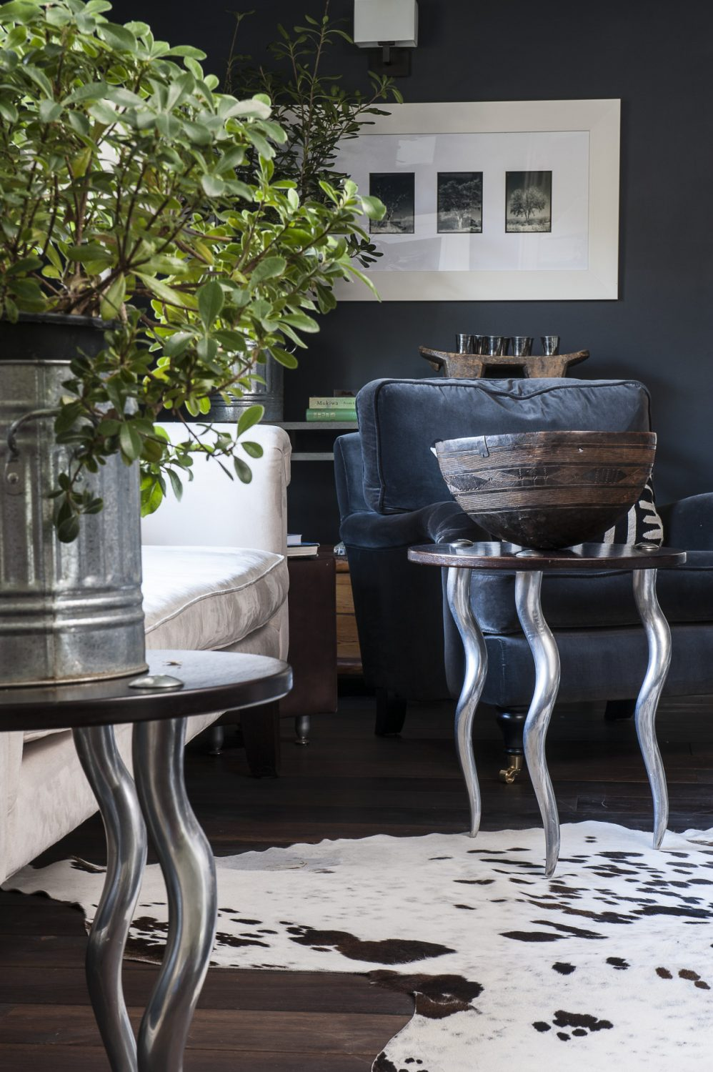The sofa is flanked by two superb tables with brushed aluminium legs in the shape of kudu horns