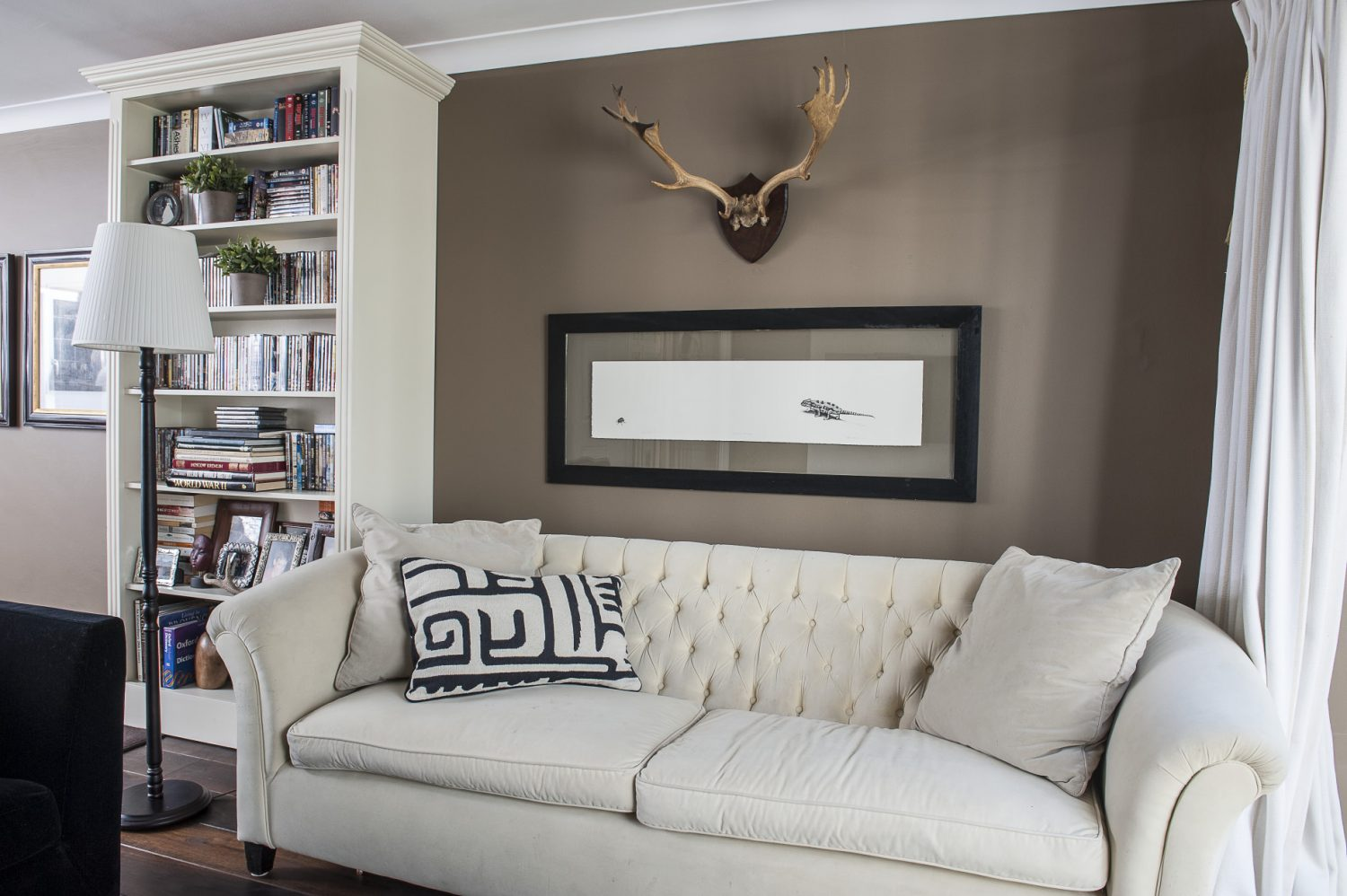In the children's room sofas – one stone, the other black – lounge around a huge TV. On the wall opposite is a pair of antlers and a great wildlife print by one of the couple's favourite artists, South African John Moore