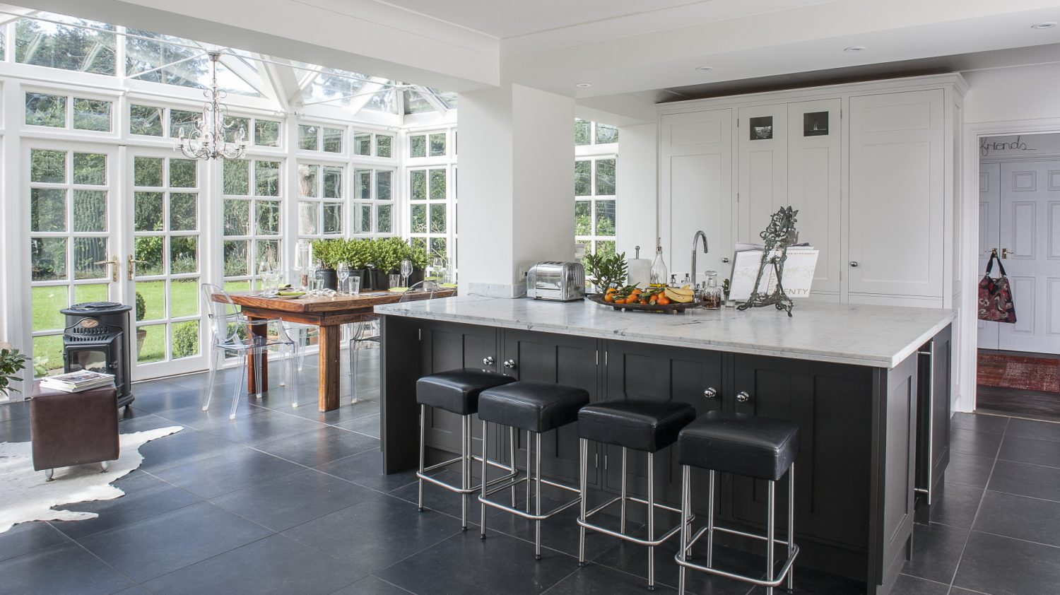 The ground floor was completely redesigned to accommodate a superb open-plan kitchen and conservatory space