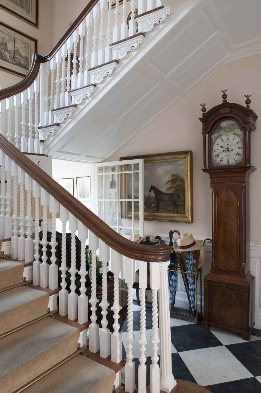 The elegantly curving staircase