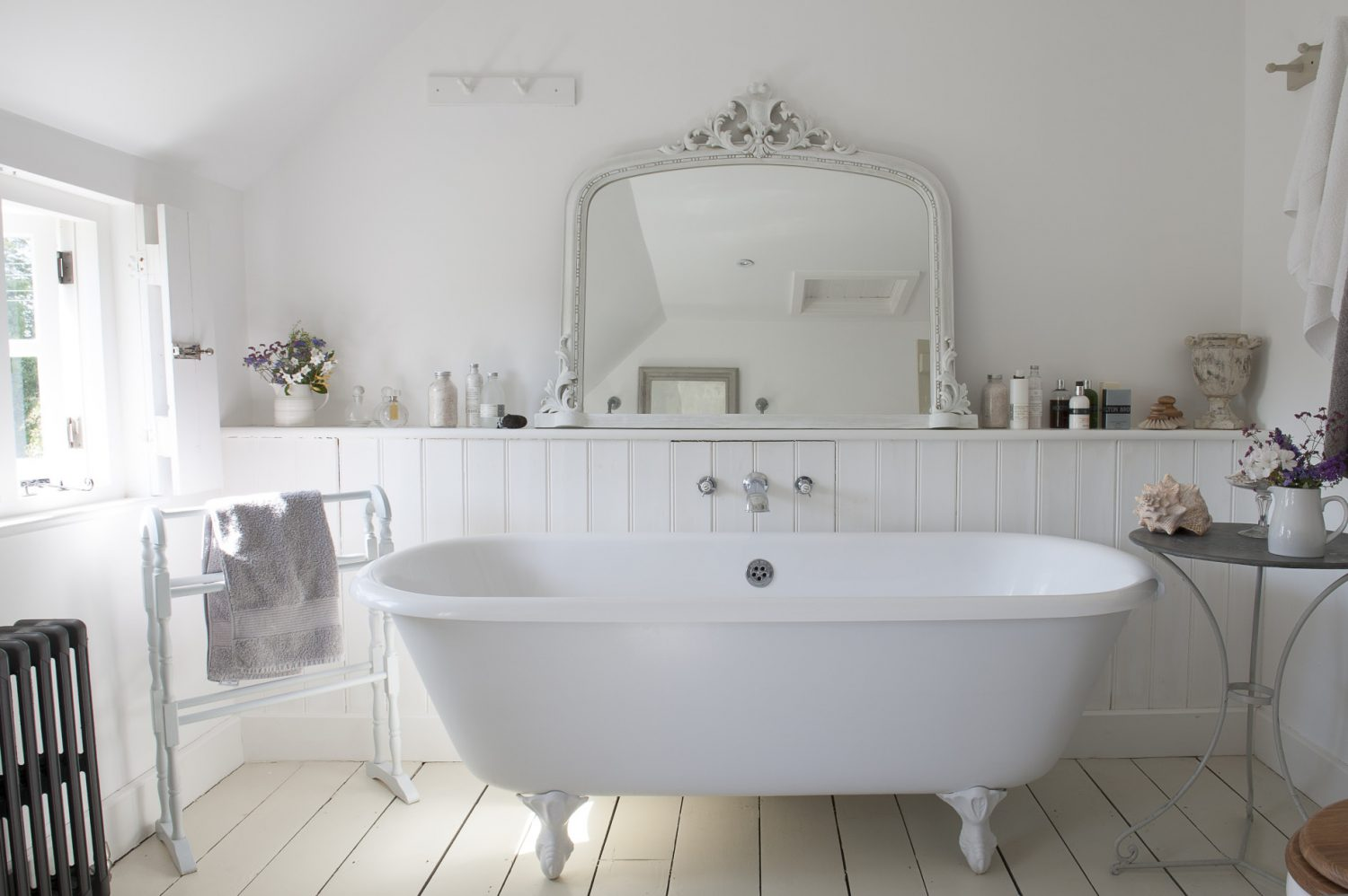 Melanie's bath is made from an amalgam of a self-reinforced cast resin and mineral mixture which means that it retains heat, but is under half the weight of an original cast-iron bath allowing it to perch safely on the first floor
