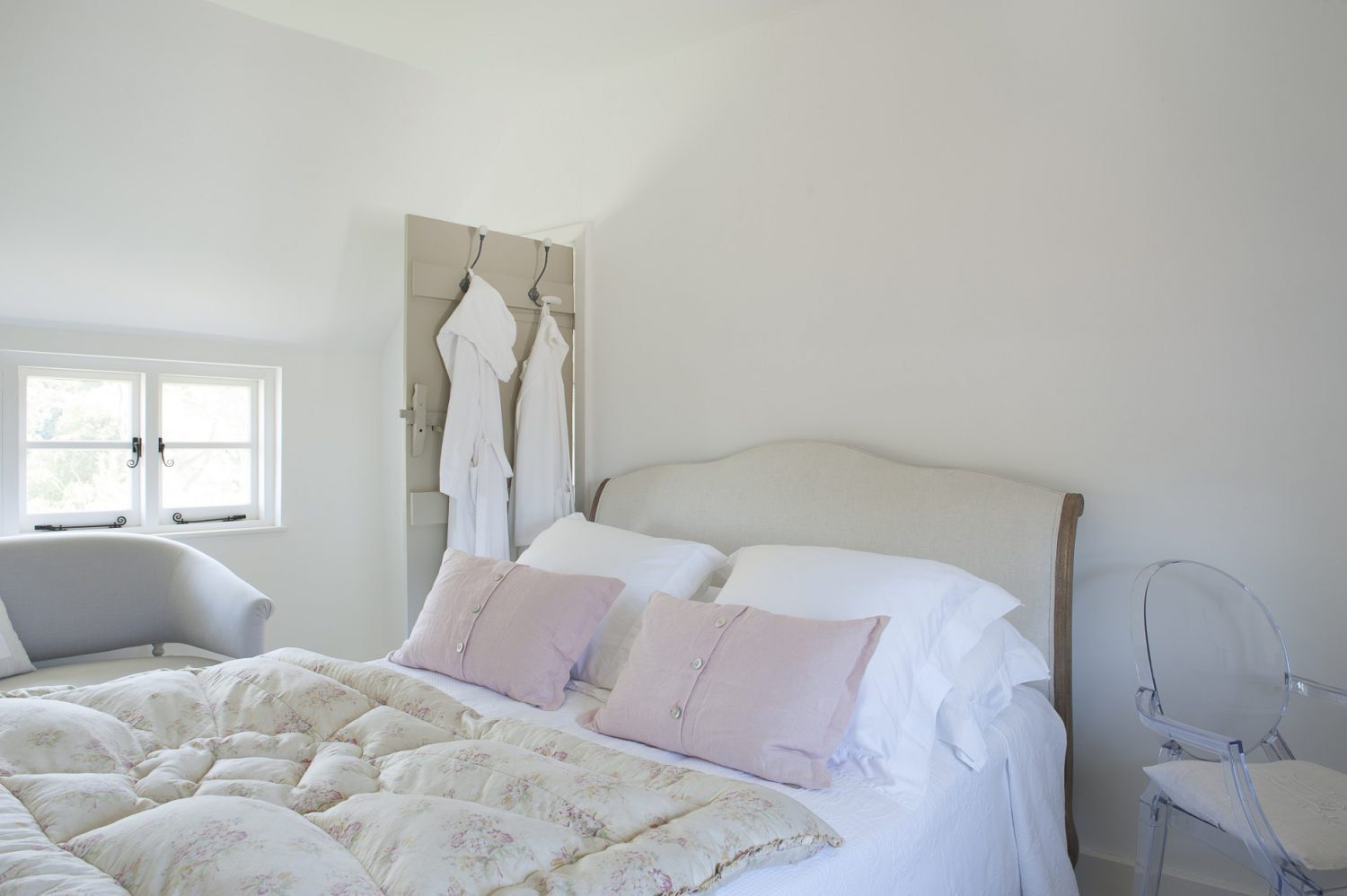 The French-style bed is a Marie Antoinette by Loaf, the chic dressing table is from The White Company and the ethereal chair that complements it is a Louis Ghost by Philippe Starck