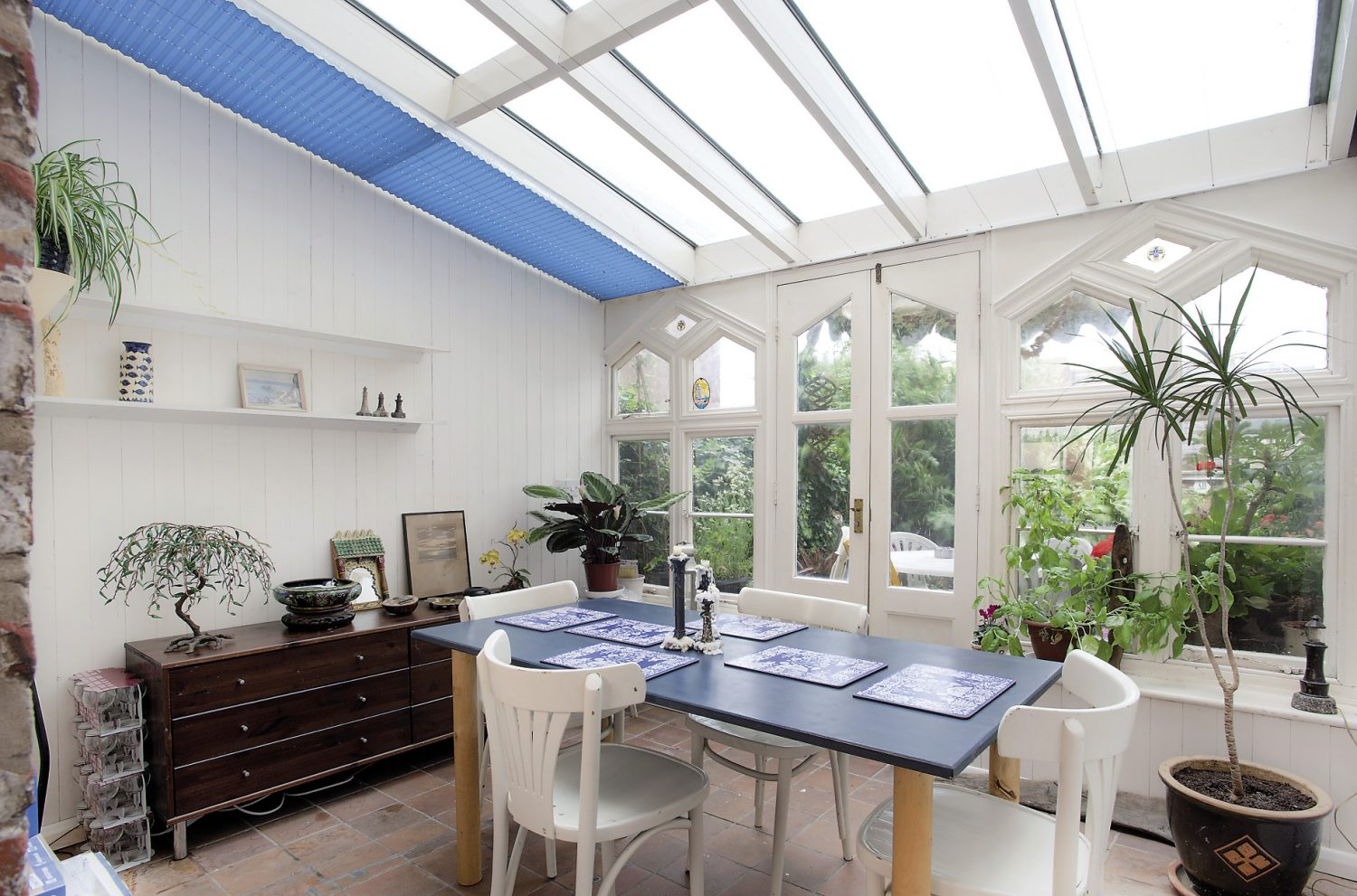Alastair found the Gothic windows in the conservatory at an architectural salvage yard and designed the room around them