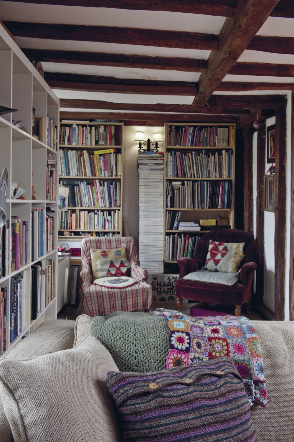 """A work in progress, Nancy's colourful crocheted 'rug of recovery"""" is draped over the back of one of the sofas."""