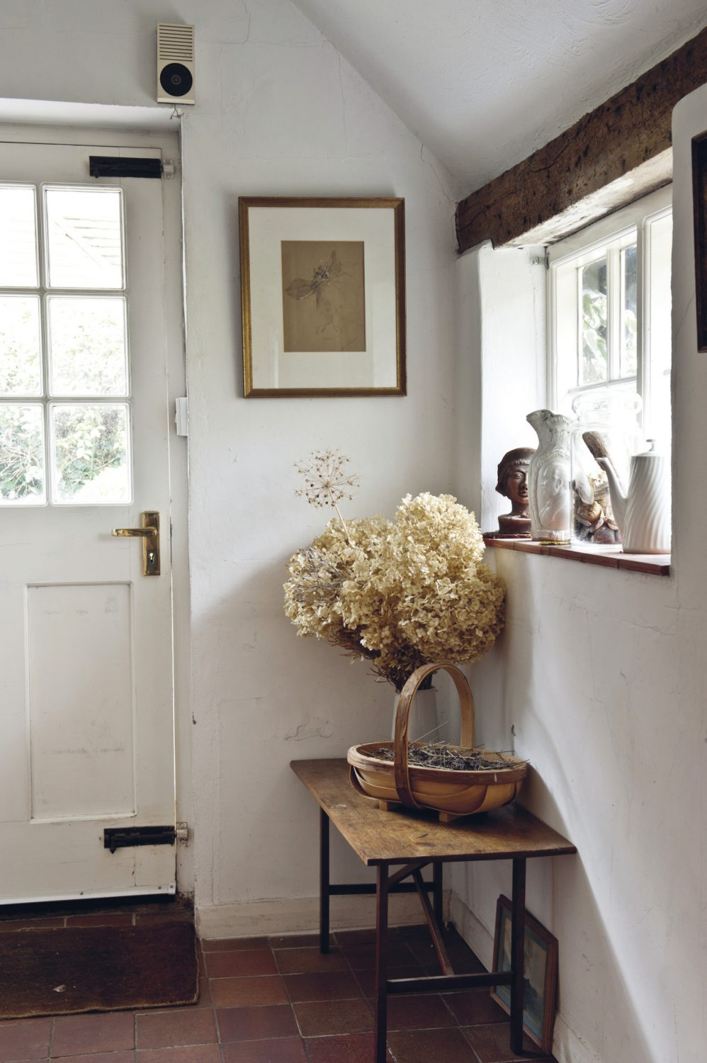 The entrance hall to Nancy Nicholson's home is enticingly adorned with intriguing objects and 'finds'.