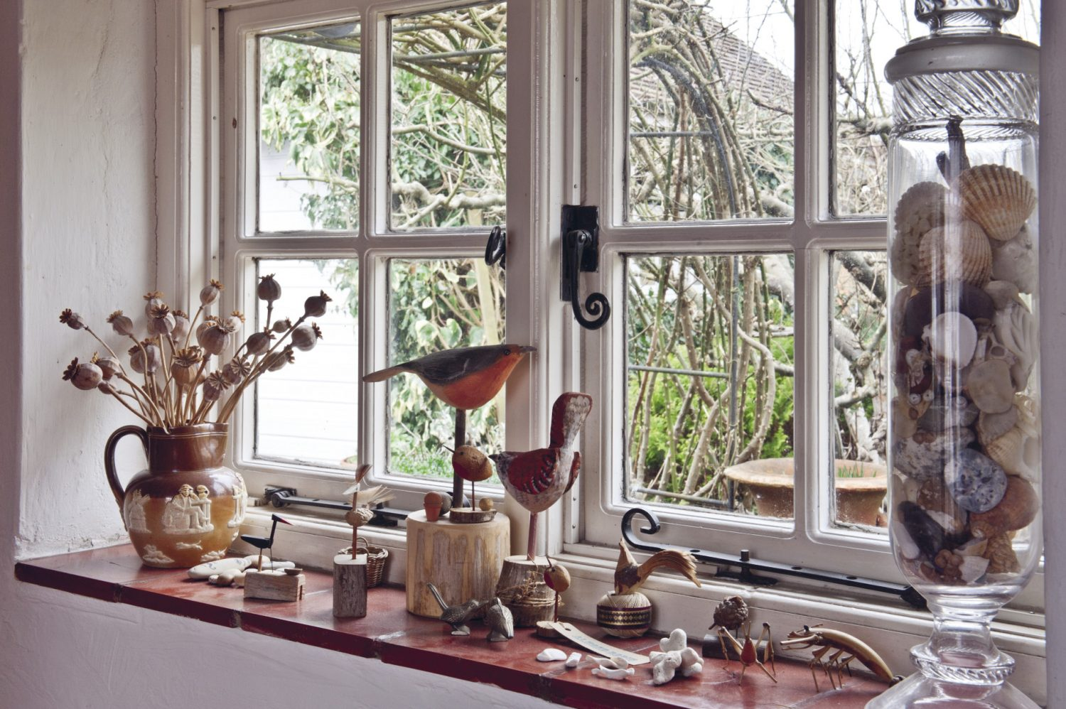 """The entrance hall to Nancy Nicholson's home is enticingly adorned with intriguing objects and 'finds'. There is a sun-bleached sheep's skull, an apothecary's jar filled with shells and several sprigs of dried wild flowers and sea grasses. An embroidered picture of the Madonna and Child in the style of a Russian icon hangs on the wall. """"That's by my mother, Joan,"""" explains Nancy"""