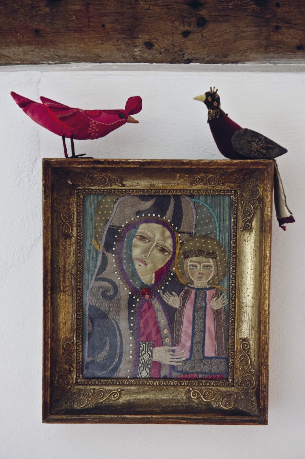 """An embroidered picture of the Madonna and Child in the style of a Russian icon hangs on the wall. """"That's by my mother, Joan,"""" explains Nancy"""