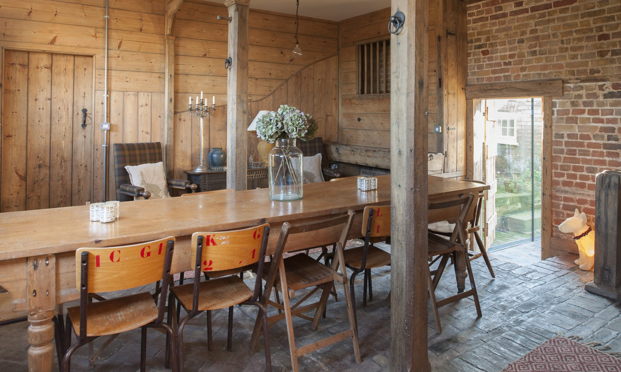The pièce de résistance of Amy and Adrian's conversion is the coach house. At one end of the room are the original hay feeders and mangers, now, like all the woodwork, sandblasted and pristine
