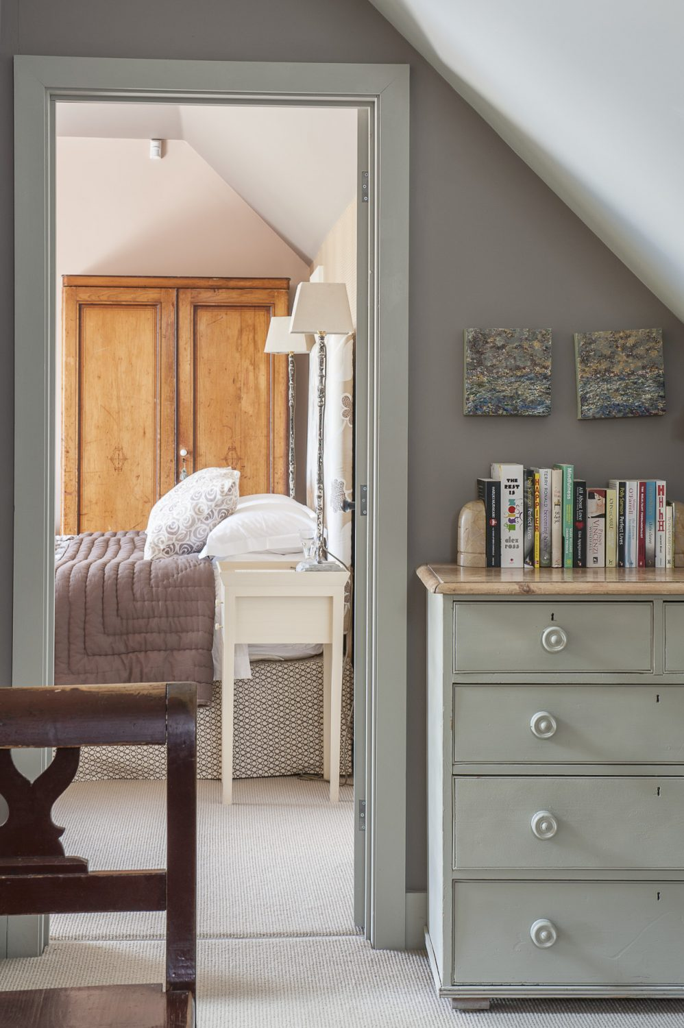 Doors lead off the spacious gallery/hallway into a guest bedroom, the master bedroom and a generously proportioned bathroom