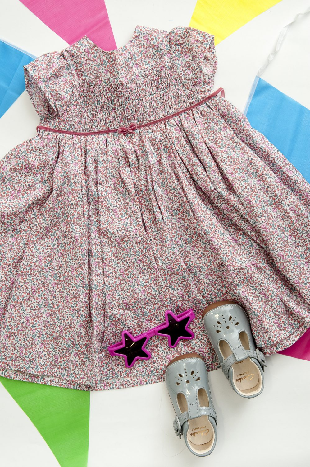 'Charlotte' dress, £59, Milliemanu 020 8878 7863 milliemanu.com; Clarks 'Little Weave' shoes, £26, The Golden Boot, Maidstone 01622 752349 thegoldenboot.co.uk
