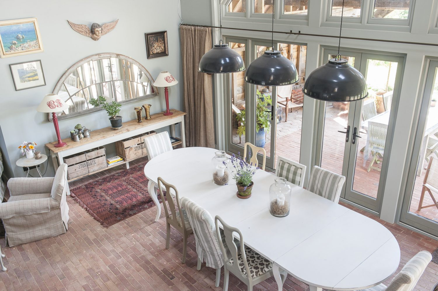 In the dining room, eight doors open outward onto a wonderful rustic covered terrace