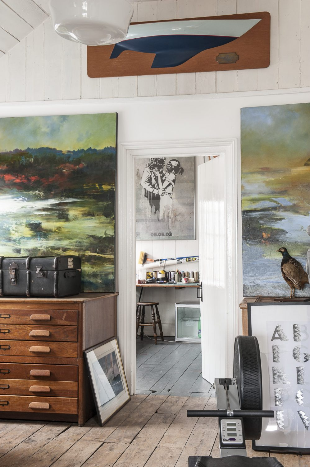 At one end of the room, Rob's son's spacious studio is tucked away behind a door