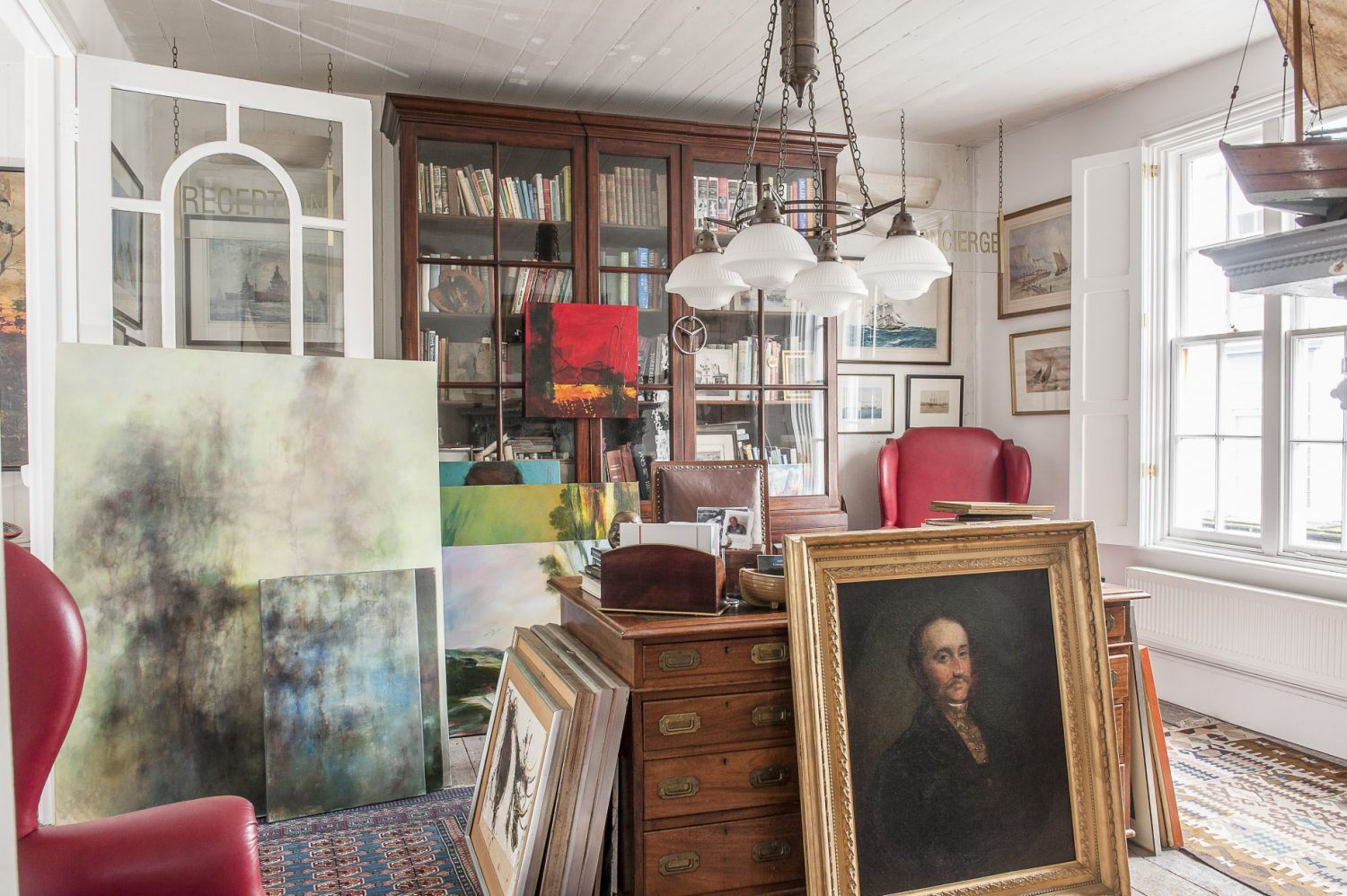 Rob's love of sailing becomes more evident as we travel through the house; his wonderful office with its captain's desk has a definite nautical feel about it, but the elegant dimensions of the room – the high Georgian ceiling, elegant decor and large window, albeit with a sea view – are more Admiralty office than Captain's cabin