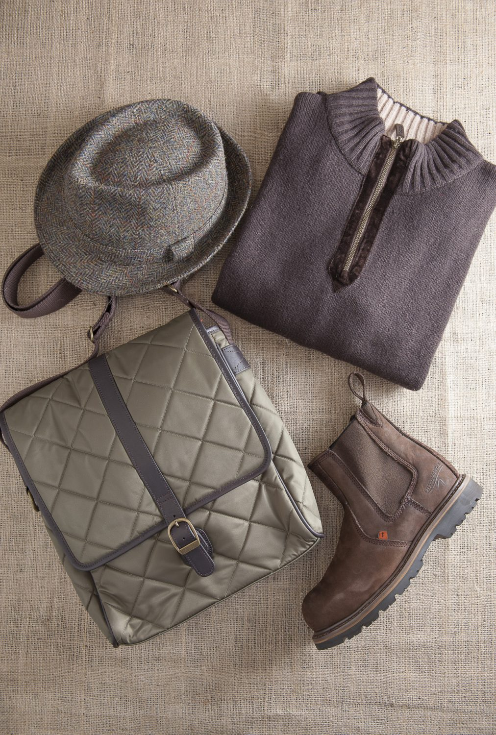 Harris Tweed trilby, £59, The Golden Fleece, Rye 01797 224271 www.thegoldenfleece.co.uk; Barbour quilted bag, £100, County Clothes, Canterbury 01227 765294 / Tenterden 01580 765159 / Reigate 01737 249224 www.countyclothesmenswear.co.uk Toggi jumper, £52.50, Buckler boots, £68.75, Charity Farm Countrystore, Cranbrook 01580 713189 www.charityfarmcountrystore.co.uk