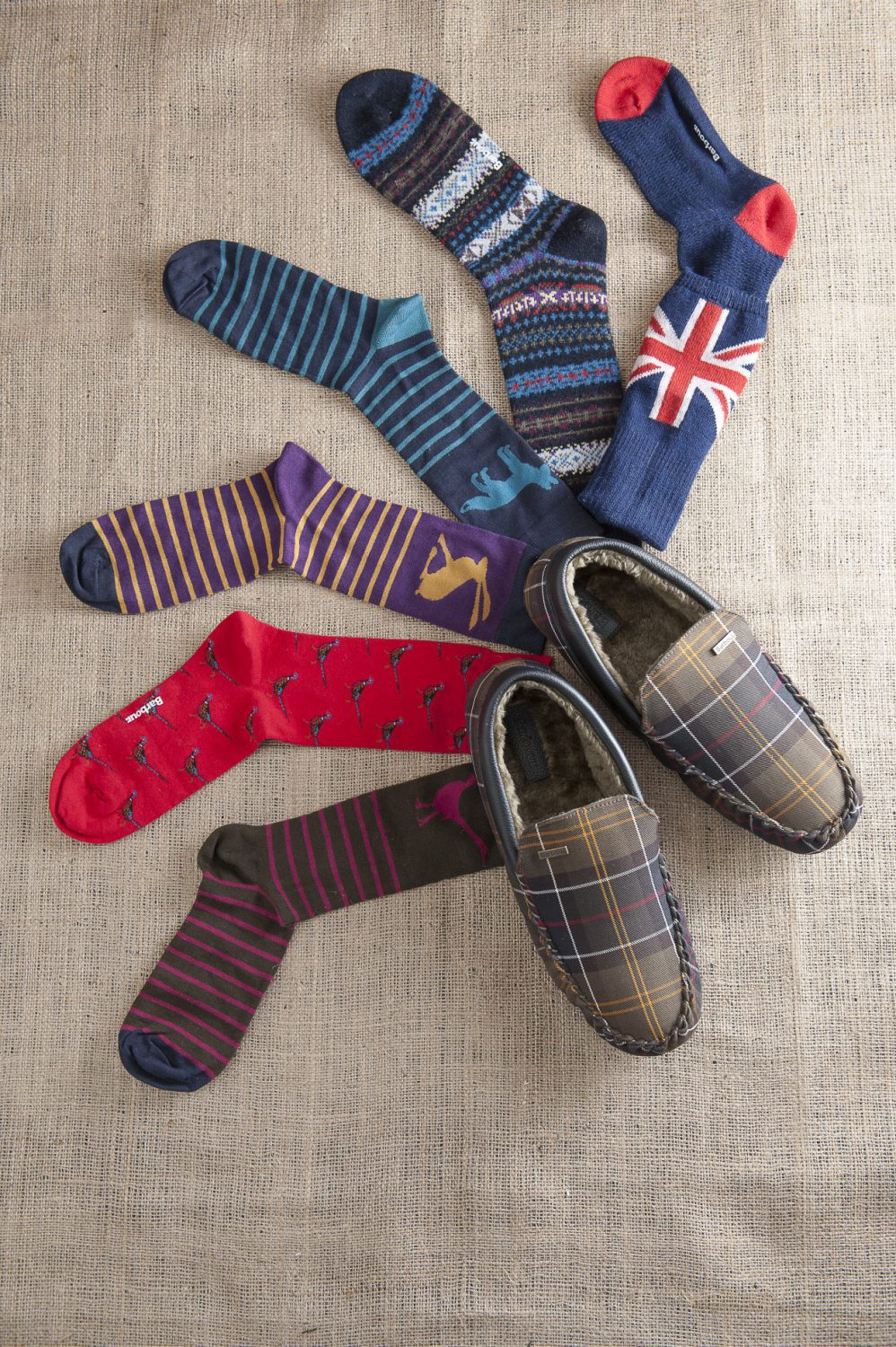Socks: Joules striped socks with pheasant, hare and fox, £19.95 for all three pairs, Charity Farm Countrystore, Cranbrook 01580 713189 www.charityfarmcountrystore.co.uk; Barbour red pheasant socks, £9.95, Barbour fairisle socks, £12.95, Barbour Union Jack socks, £12.95, Barbour slippers, £54.95, The Golden Fleece, Rye 01797 224271 www.thegoldenfleece.co.uk