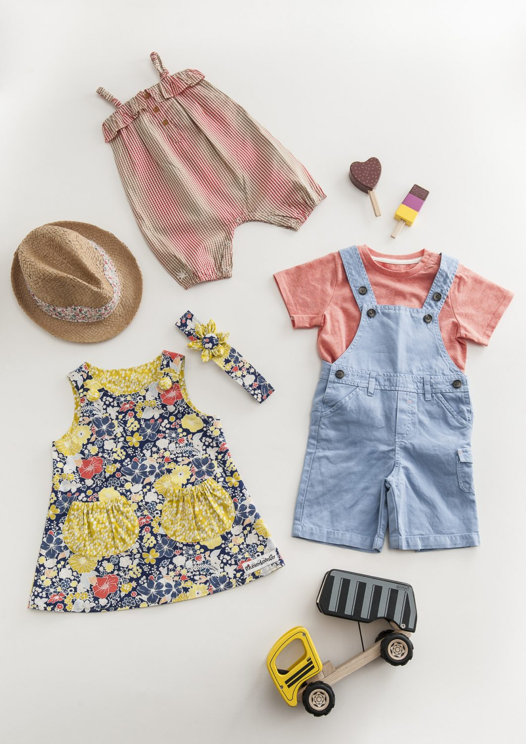 No Added Sugar jumpsuit, £34.95, Mini A Ture palm tree t-shirt, £22.95, Tartine et Chocolat dungarees, £29.95, Kidella, Tenterden 01580 765021 www.kidella.co.uk; trilby sun hat, £22, Tatty Tess www.wealdenfairs.com/tattytess; electric & apple reversible dress & matching flower headband, £40, MummyLovesLily www.wealdenfairs.com/mummyloveslily; set of 6 wooden ice-lollies, £15, wooden dumper truck, £30, Thumbelina, Tenterden 01580 763303 www.thumbelinatoys.co.uk