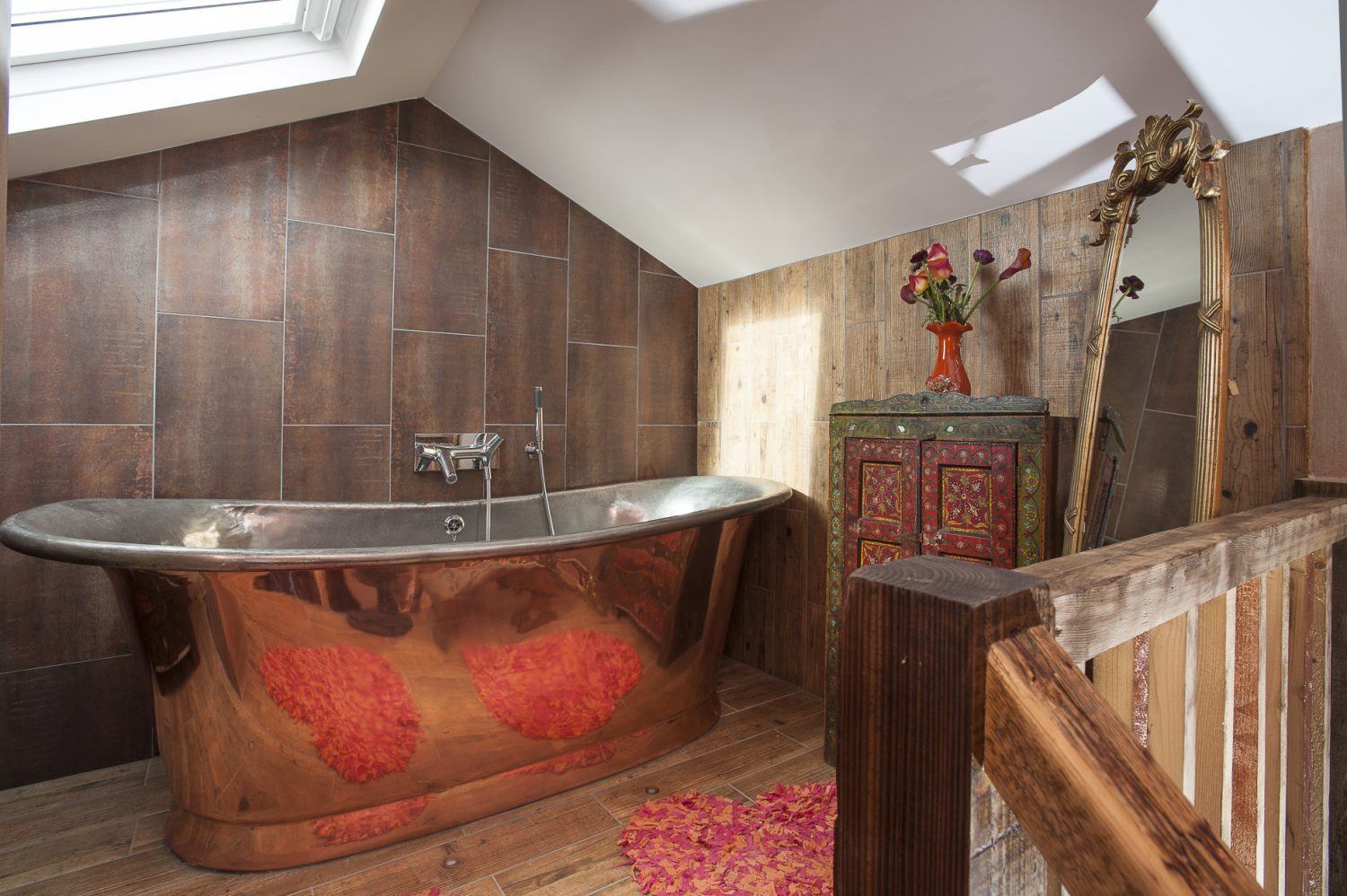 The whole bathroom has been modelled around Nadene's magnificent William Holland copper bath