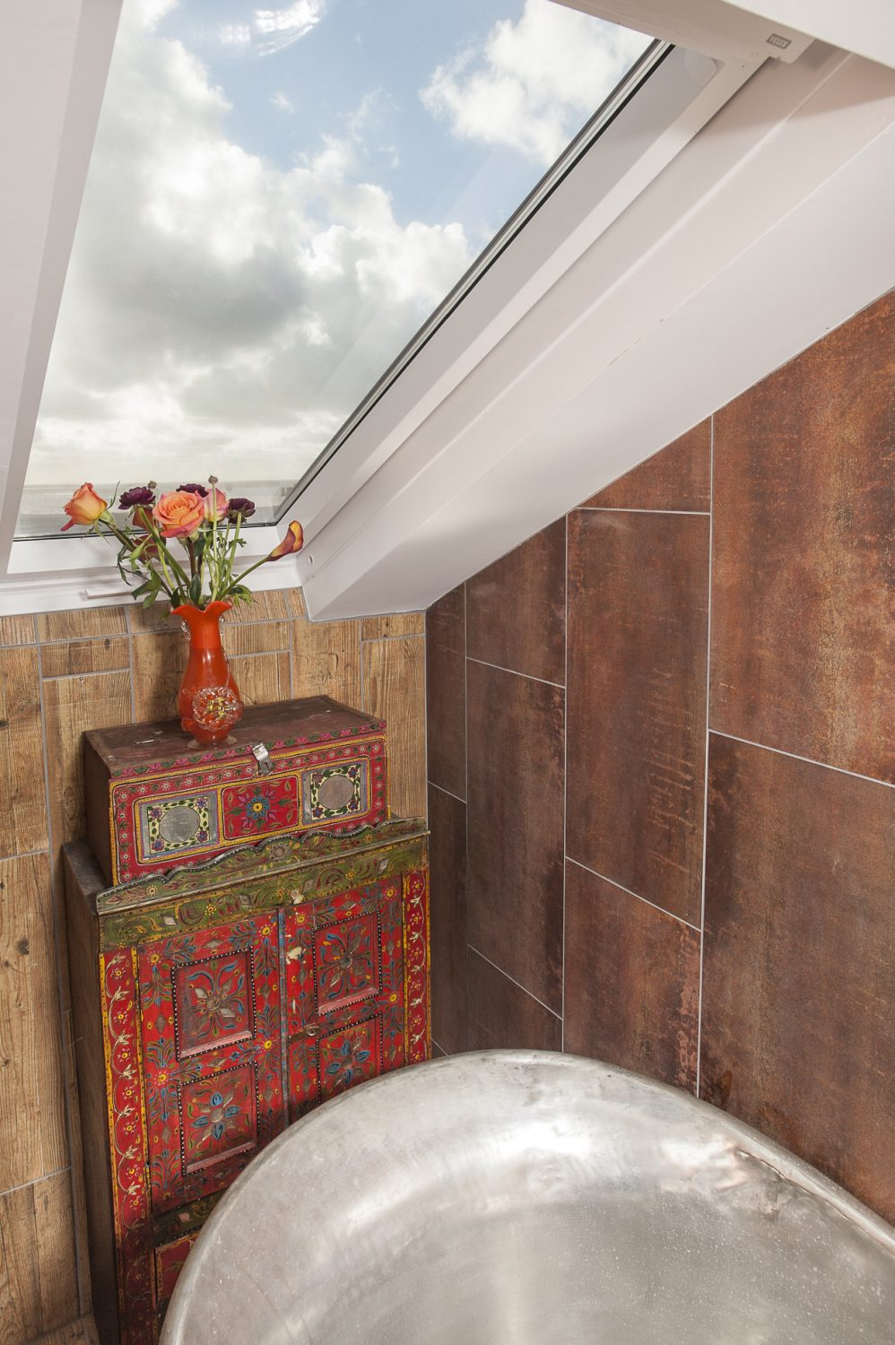 Wooden panels used to line the shower and portions of the bathroom walls are actually ceramic tiles