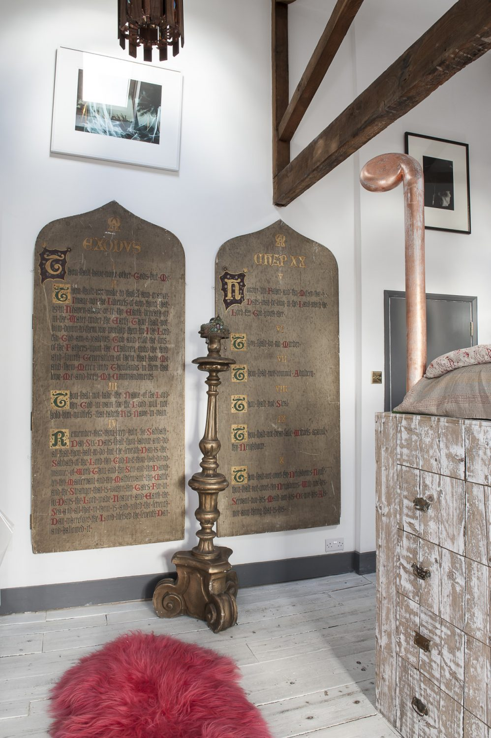 On the wall are mounted two seven-foot high 'tablets' of the ten commandments reclaimed from a church near Lydd, an Alan Rankle triptych and an ethereal Kirsten Reynolds light photograph