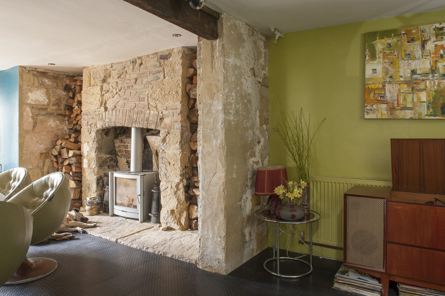 The exposed sandstone fireplace