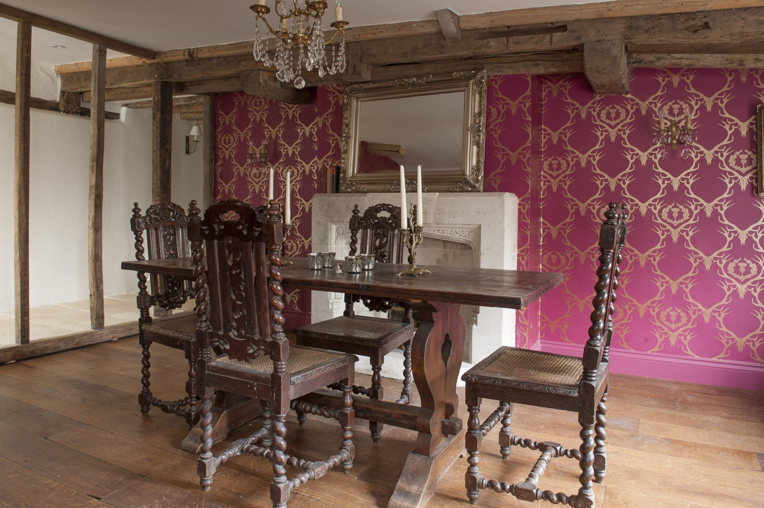 The heavily beamed dining room across the hall from the kitchen now has a distinctly baronial feel