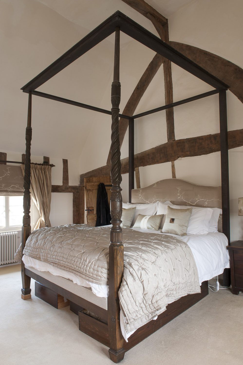 """The previous owner asked if we'd like to buy the bed, which with all the canopy had originally cost £13,000,"" says Charlotte. ""It was lovely but out of our budget so we had to say no. So we were pleasantly surprised to find it still here when we moved in."""