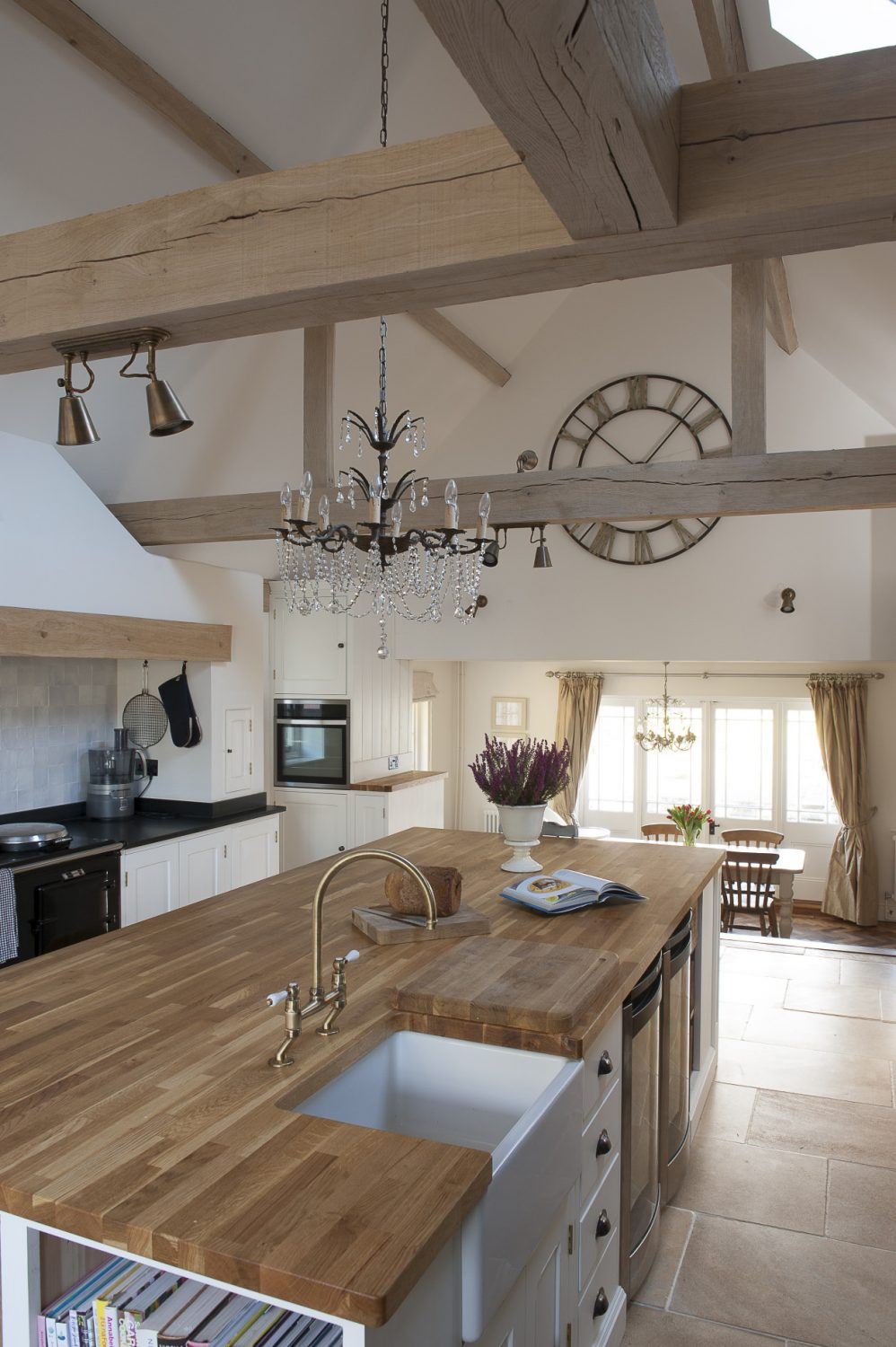 The kitchen/breakfast room was extended to create a truly huge vaulted, beamed space