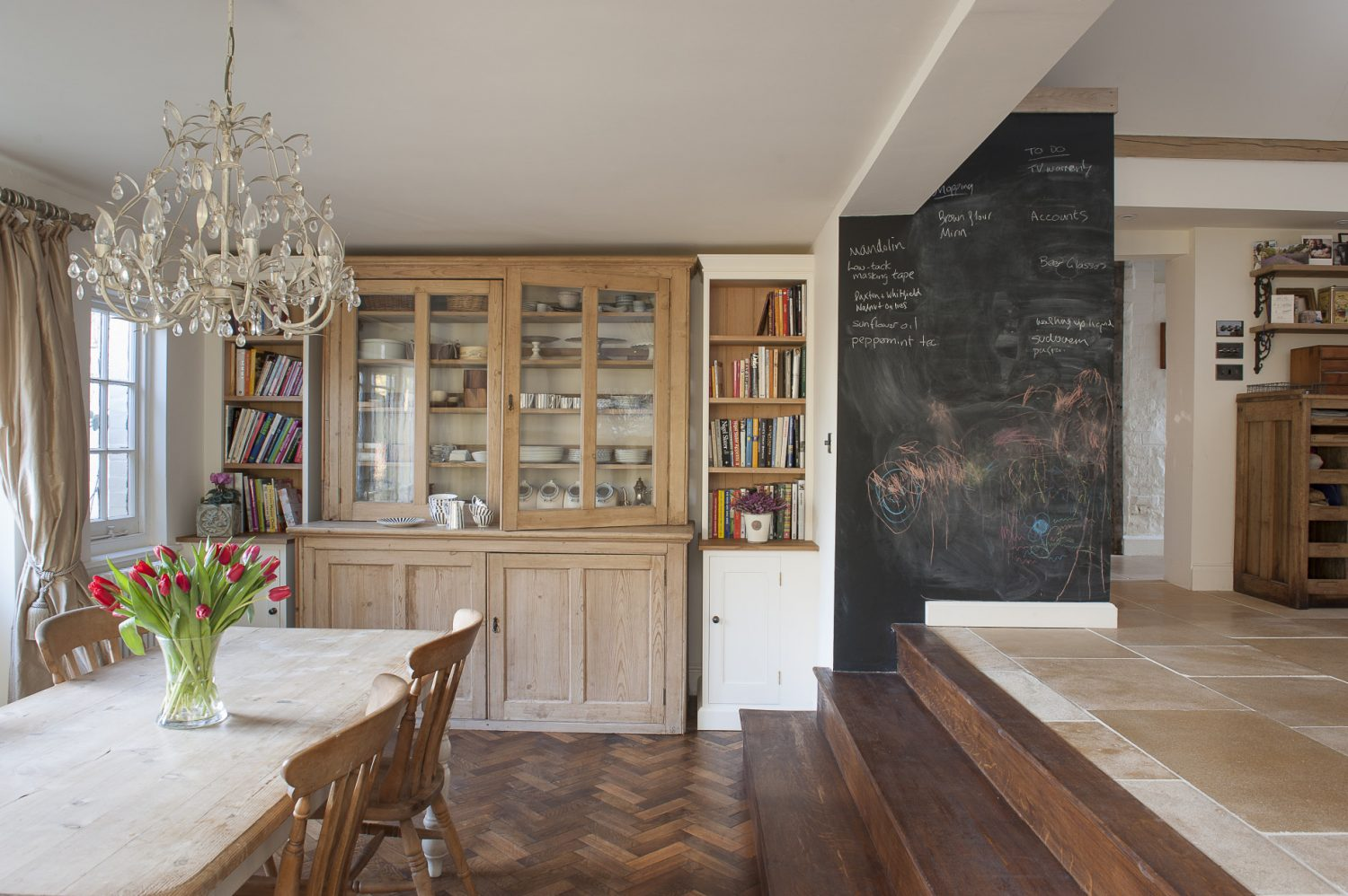 Steps from the kitchen lead down into the bright and airy breakfast room