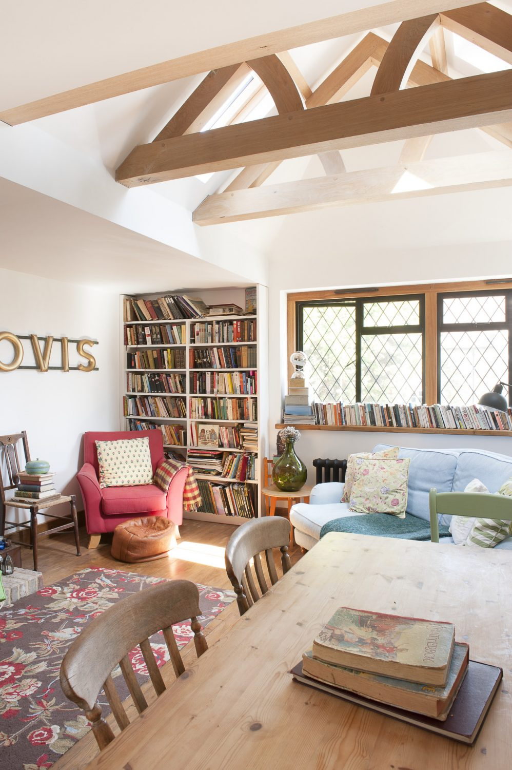 The bright dining room is filled with an eclectic mix of books rescued from the tip