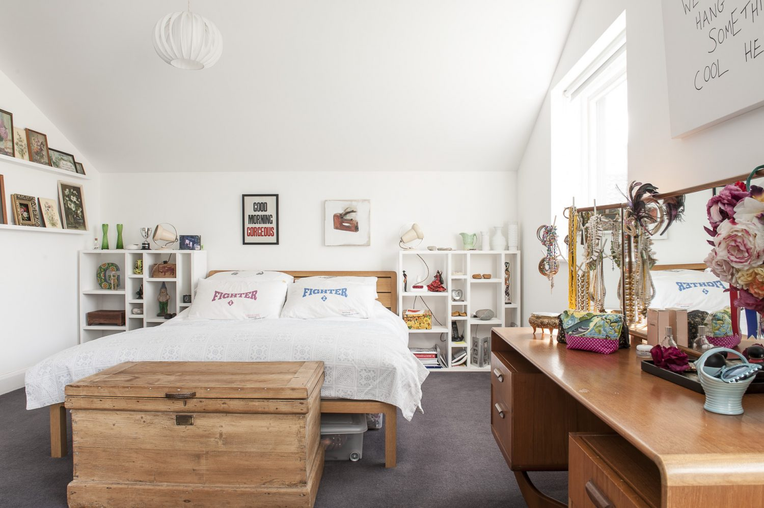 The master bedroom is a spacious haven, with lots of the couple's humorous touches