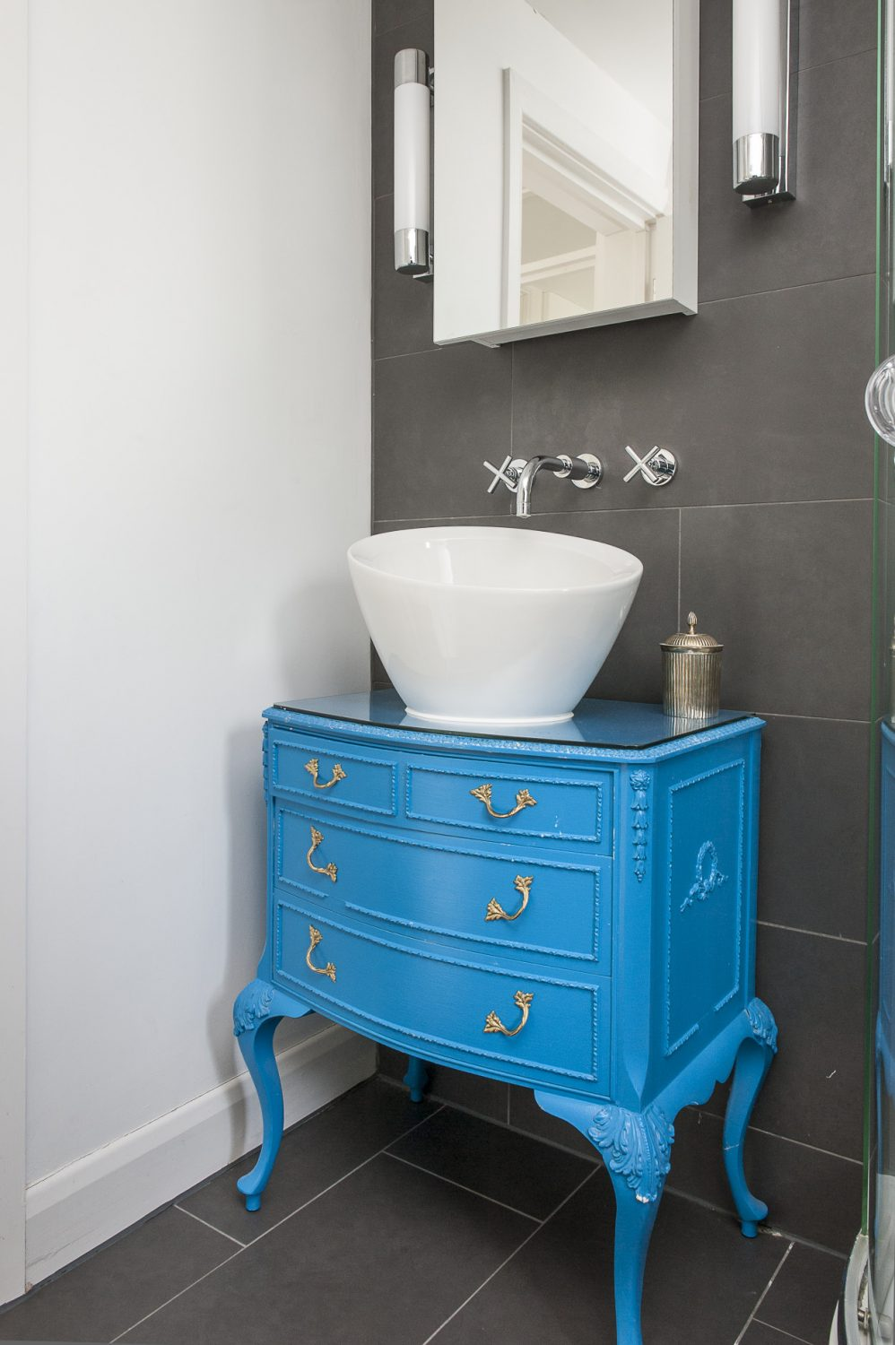 "Hannah has re-purposed an old chest of draws and painted it bright blue ""I don't like old brown wood so I've painted quite a few pieces of furniture. (The chest of drawers) was a bit of a fiddle at first. But now it's easy – these can be made to order if people want them."""