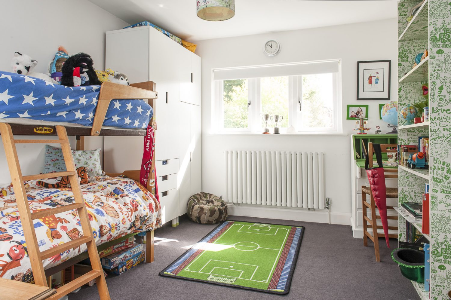 The children's rooms feature an eclectic mix of vintage toys and bold, contemporary accessories