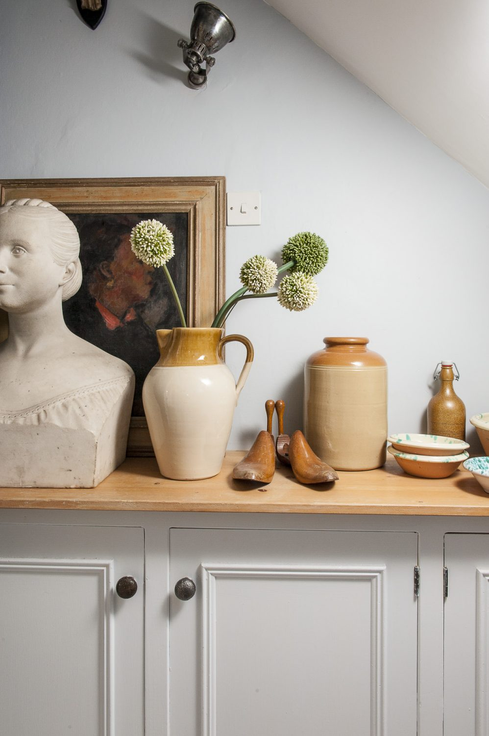 In the hallway is an 19th century bust of a beautiful woman that Diana found in London where she still sources many of her pieces, a Duncan Grant and a wartime 'Shelter' sign