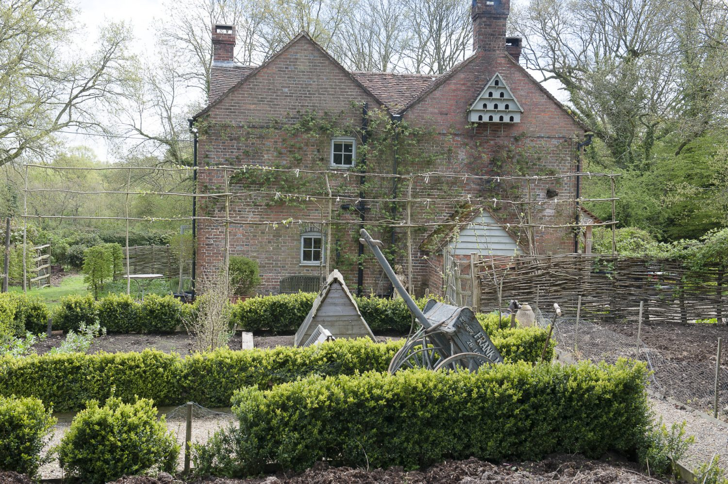 The idyllic kitchen garden offers a plentiful supply of fruit and vegetables and is home to the family's quail and beehives